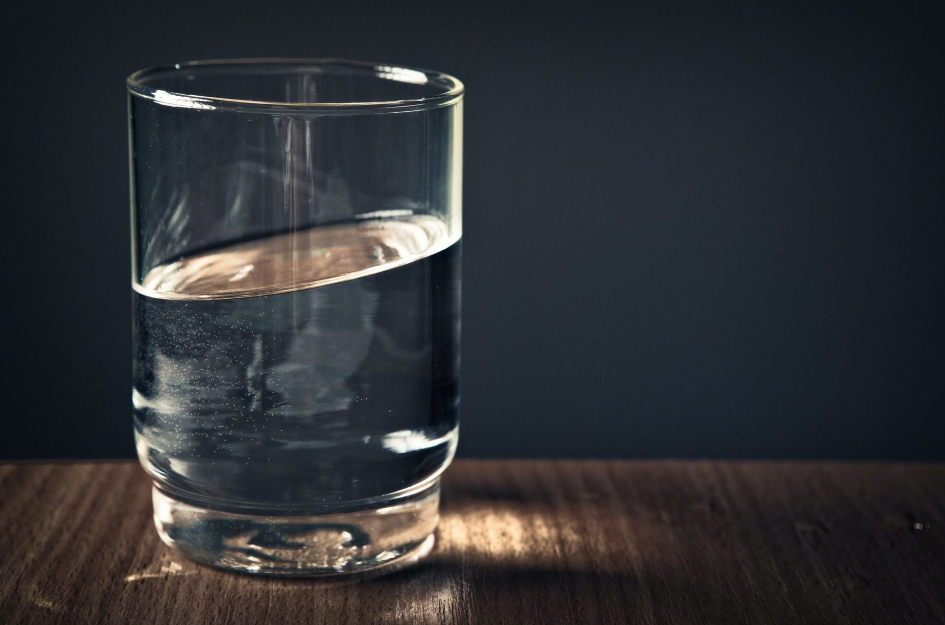 glass of water in dim-lit room