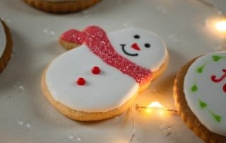 christmas cookies with lights on countertop